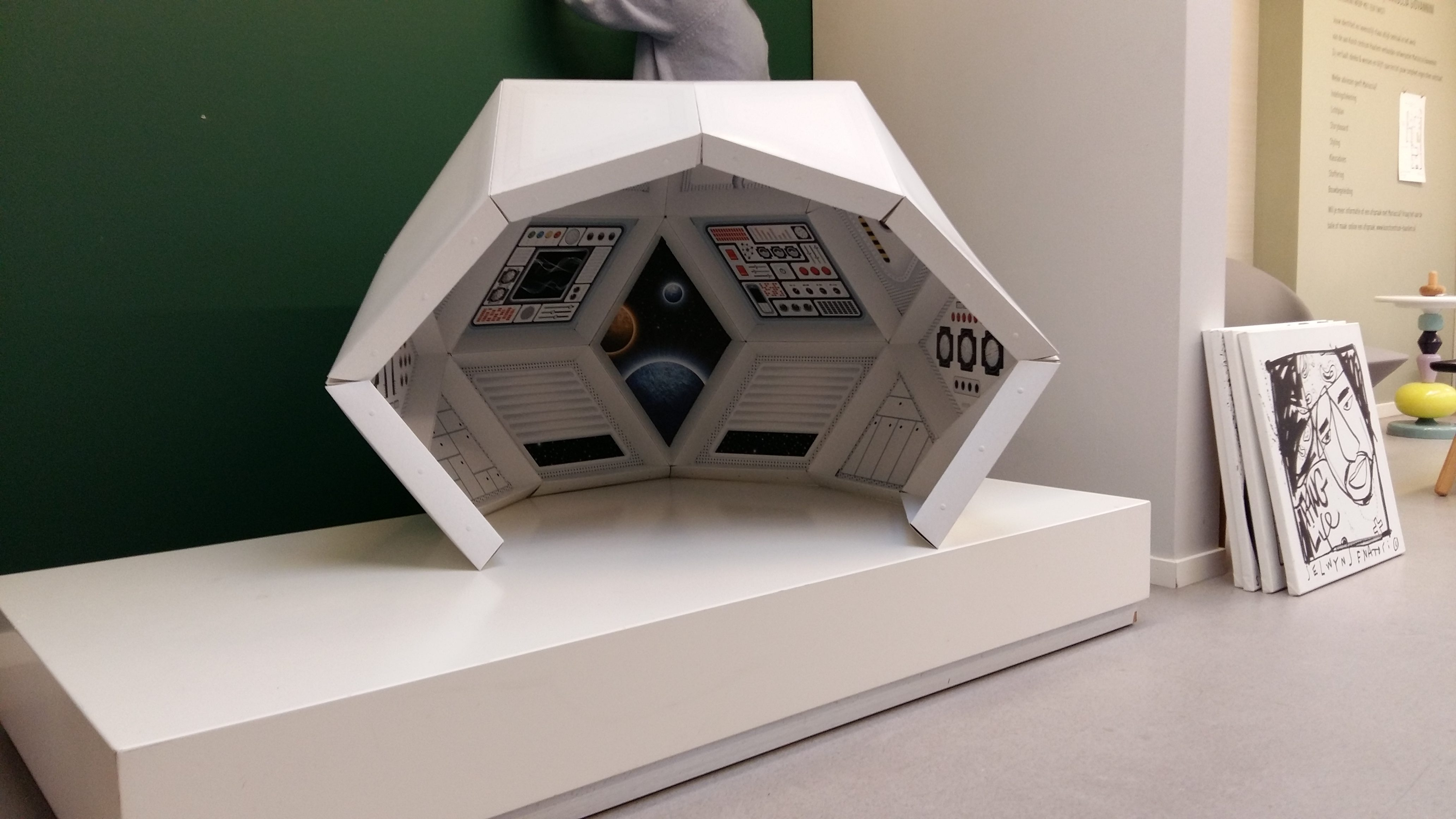 cardboard playhouse exhibited